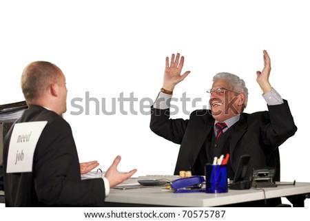 senior manager laughing at job applicant - stock photo