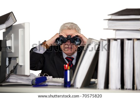 senior manager looking through binoculars - stock photo