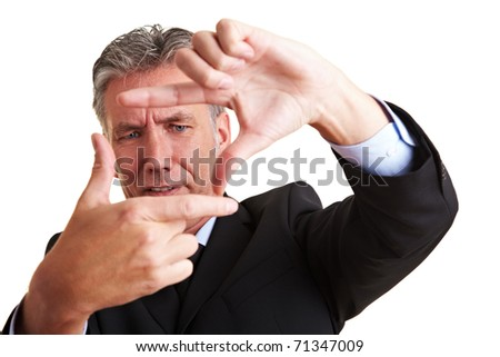 Senior manager making a frame with his fingers - stock photo