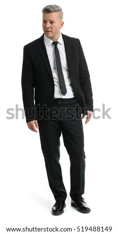 Senior manager wearing a suit. Full length portrait of businessman isolated on white background