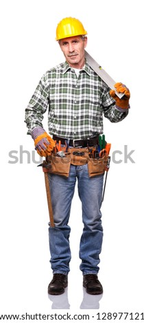senior manual worker with spirit level - stock photo