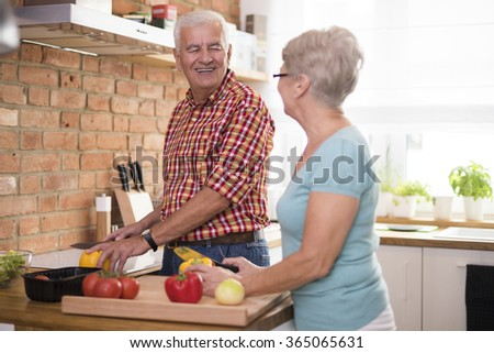 Senior marriage cooking dinner together