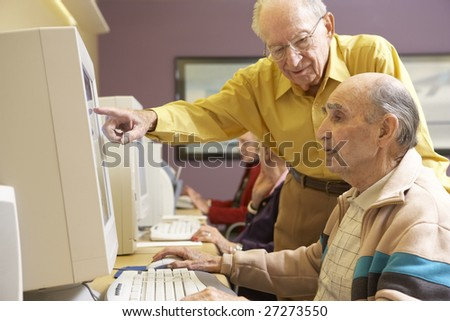 Senior men using computer - stock photo