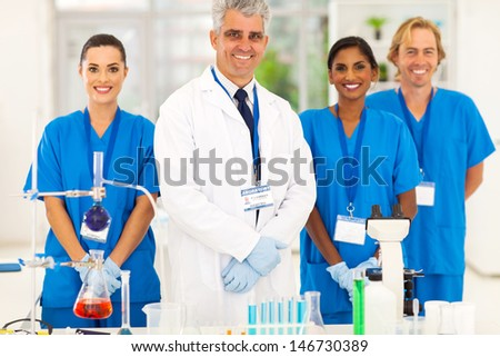 senior microbiology specialist with science student in the lab - stock photo