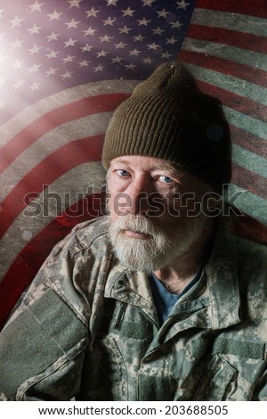 Senior military man in front of American flag with a rough background - stock photo