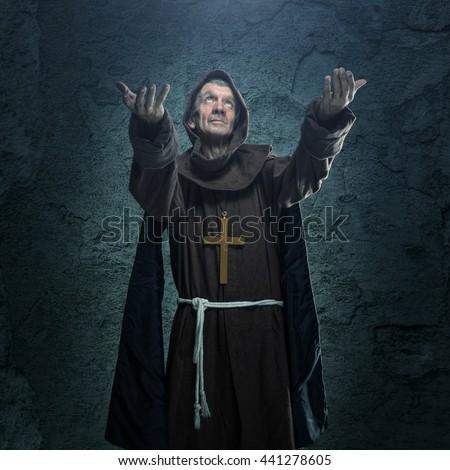 Senior monk praying - stock photo