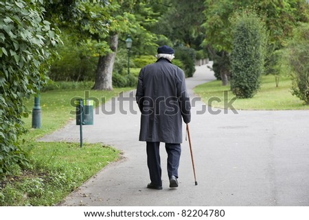 Senior morning walk in a Vienna park at summertime. - stock photo