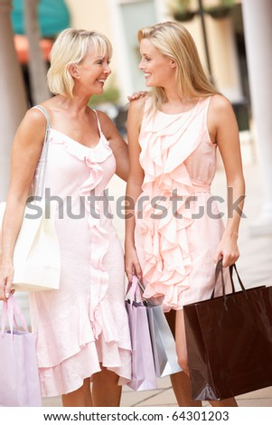 Senior Mother And Daughter Enjoying Shopping Trip Together