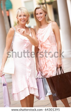 Senior Mother And Daughter Enjoying Shopping Trip Together - stock photo