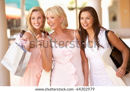 Senior Mother And Daughters Enjoying Shopping Trip Together - stock photo
