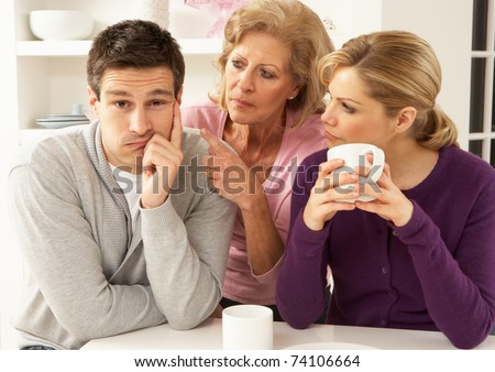 Senior Mother Interfering With Couple Having Argument At Home - stock photo