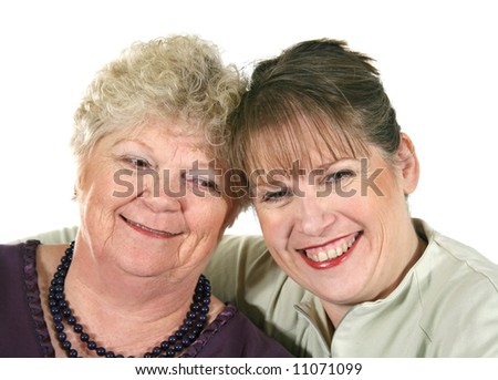 Senior mother with her middle aged daughter laughing.