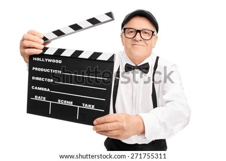Senior movie director holding a movie clapper, smiling and looking at the camera isolated on white background - stock photo