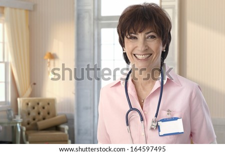 Senior nurse at elegant elite nursing-home smiling. - stock photo