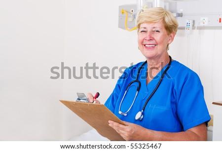 senior nurse in hospital ward - stock photo