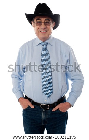 Senior old man wearing a cowboy hat isolated on white - stock photo