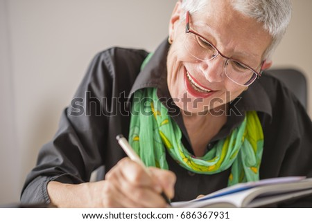 Senior Old Woman Writing Down Letters Stock