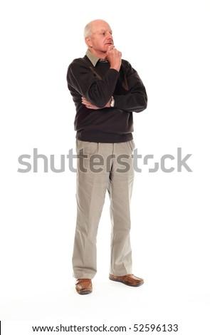 Senior older retired man on white background standing and thinking - stock photo