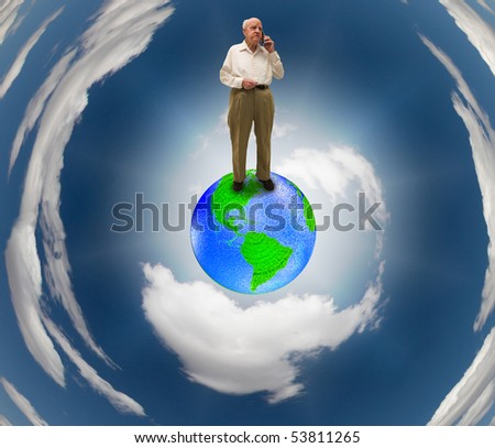 Senior on Earth using Cell phone - stock photo
