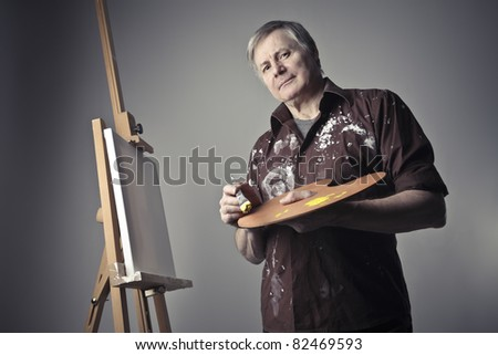 Senior painter holding a palette - stock photo
