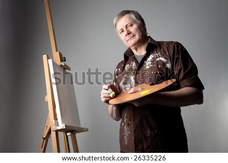 senior painter in his atelier - stock photo