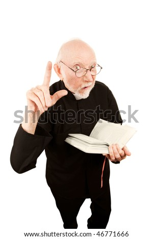 Senior pastor delivering fiery sermon and holding a Bible - stock photo