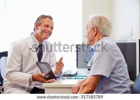 Senior Patient Having Consultation With Doctor In Office - stock photo