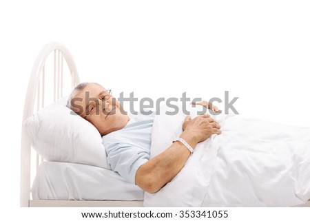 Senior patient lying on a hospital bed and looking at the camera isolated on white background - stock photo