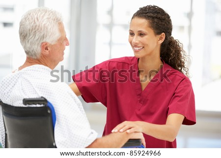 Senior patient with young doctor - stock photo