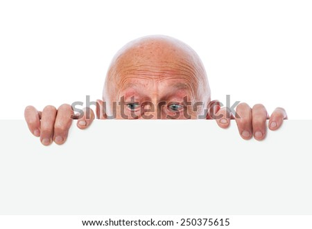 senior peeps over top of blank white paper - stock photo