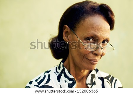 Senior people and confidence, portrait of proud african american woman with glasses smiling and looking at camera. Copy space - stock photo
