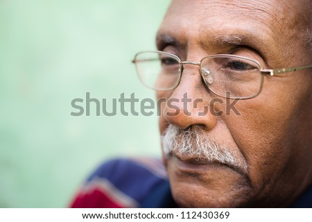 Senior people and feelings, portrait of sad old black man with glasses and mustache. Copy space - stock photo
