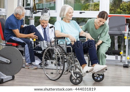 Senior People Being Assisted By Physiotherapists In Rehab Center - stock photo