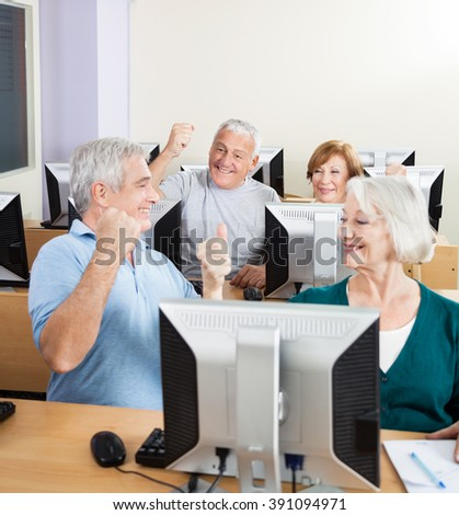 Senior People Cheering In Computer Class - stock photo