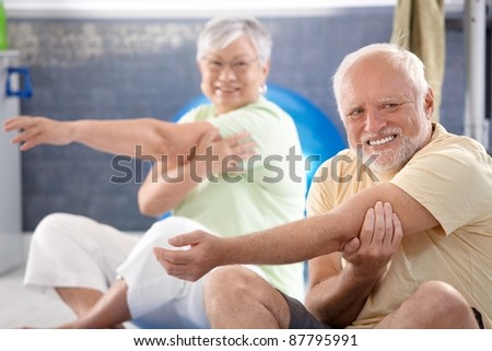 Senior people doing stretching exercises in the gym.? - stock photo