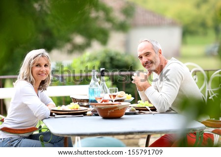 Senior people having lunch in garden