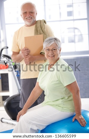 Senior people in the gym, smiling, looking at camera. - stock photo