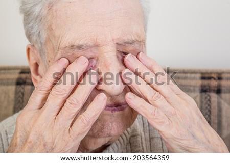 senior person hiding - stock photo