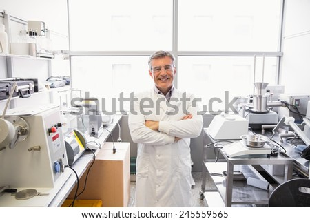Senior pharmacist smiling at camera at the laboratory