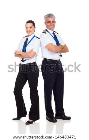 senior pilot and female co-pilot full length portrait on white - stock photo