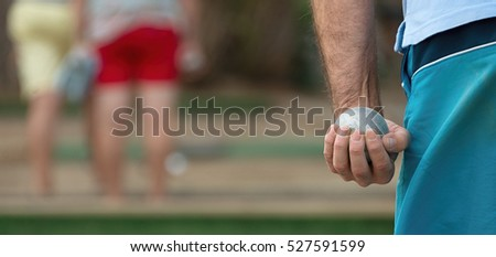 Senior playing petanque,fun and relaxing game.Petanque ball in hand of man