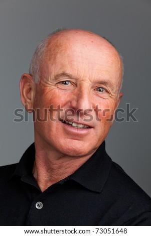 Senior Portraits. Portrait of a friendly elderly man. Recording in the studio. - stock photo