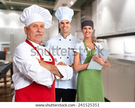 Senior professional chef man and group of people - stock photo