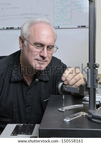 Senior Quality Inspector checking dimensions on a manufactured product