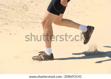 Senior runner in nature dunes - stock photo