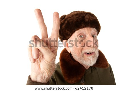 Senior Russian Man in Fur Cap and Jacket Making Peace Sign