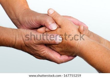 Senior's hands clasped, close up,Selective focus. - stock photo