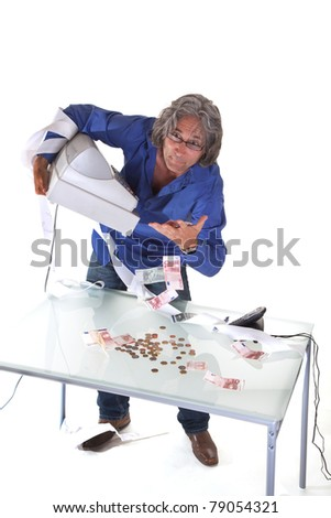 Senior salesman  making up his cashflow at the and of the day - stock photo