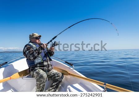 Senior sea fishing action - stock photo