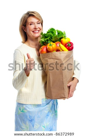 Senior shopping woman with grocery items . Isolated over white background.